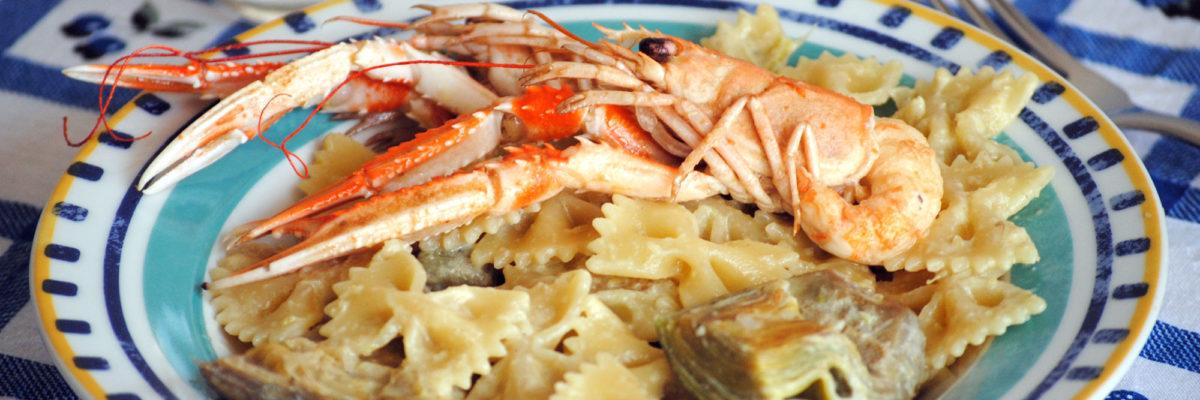 Pasta con carciofi e scampi