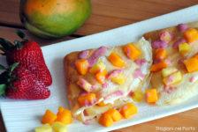 Crêpe ananas e mango con salsa alle fragole