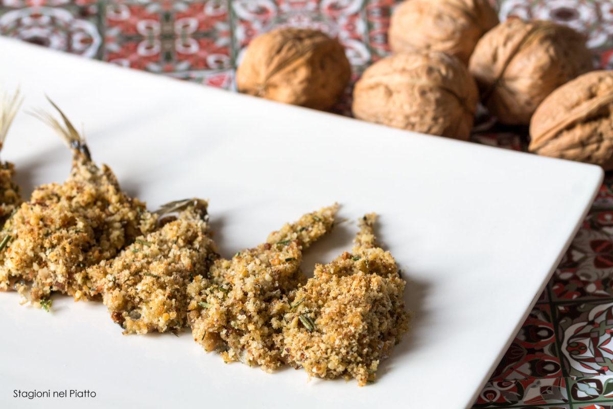 Sardine al forno gratinate con erbe e noci