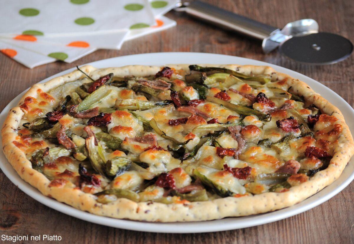 Finta pizza di sfoglia con puntarelle e scamorza