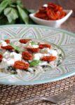 Risotto al basilico con stracciatella e pomodorini confit